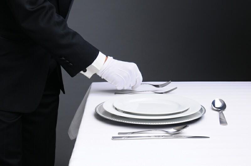 Waiter using white glovess